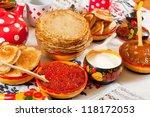 Traditional russian pancake with caviar and tea - stock photo