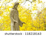 Jesus Christ statue in a cemetery at fall - stock photo