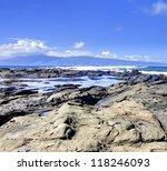 Island Maui tropical cliff coast line with ocean. Hawaii. Lava rocks and day light. - stock photo