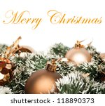 Christmas decoration with golden ornaments isolated on white - stock photo