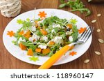 Salad with pumpkin, feta and arugula on a plate - stock photo