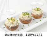 Stuffed mushrooms, baked with cheese and herbs, selective focus on center mushroom - stock photo
