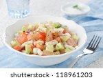 A bowl of salad with squid, avocado and grapefruit, closeup horizontal - stock photo