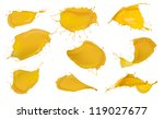 Shot of yellow paint splashes, isolated on white background - stock photo