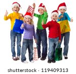 Group of happy kids with christmas gifts and thumbs up sign, isolated on white - stock photo