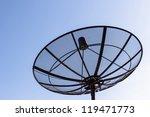 Single satellite dish with twilight blue sky background - stock photo