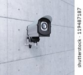 cctv camera looking to the right on concrete wall - stock photo