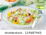 Salad with grapefruit, oranges, lettuce and cheese on a plate - stock photo