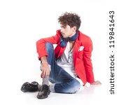 Une isolated fashion man sit on white background - stock photo