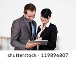 Business meeting with digital tablet - stock photo