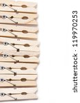 Set of wooden clothes pins on white background with copy space. - stock photo