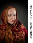 Portrait of pretty Slavonic girl with red braided hair, looking away - stock photo