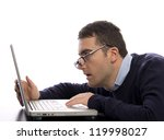 worker stressed and worried reading bad news on his computer - stock photo