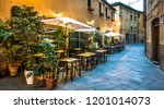 typical italian sidewalk restaurant - photo - stock photo