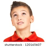 Portrait of adorable young boy looking up. Isolated on white - stock photo
