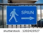 Sign pointing to Spain at the Border with Gibraltar a British overseas territory - stock photo