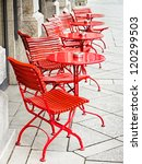 tables and chairs at a sidewalk cafe in rome - italy - stock photo