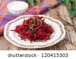 salad of fresh beets and carrots with parsley sprinkled with sesame seeds on a plate - stock photo