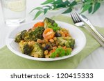warm salad with chickpeas, broccoli and raisins on the plate, horizontal - stock photo