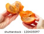 Ripe persimmon in hand isolated on white background - stock photo
