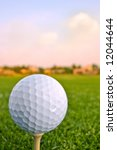 golf ball on tee in morning - stock photo
