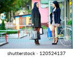 two elegant women shopping in the city store - stock photo