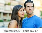 Closeup portrait of a happy young couple looking at something interesting - stock photo