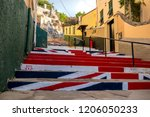 Gibraltar, United Kingdom, 3rd October 2018:- Steps painted with the British flag in Gibraltar. Gibraltar is a British Overseas Territory located on the southern tip of Spain. - stock photo