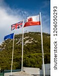 Gibraltar, United Kingdom, 1st October 2018:- The flags of Gibraltar, United Kingdom and the EU flying in Gibraltar. Gibraltar is a British Overseas Territory located on the southern tip of Spain. - stock photo