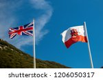 Gibraltar, United Kingdom, 1st October 2018:- The flags of Gibraltar,and United Kingdom flying in Gibraltar. Gibraltar is a British Overseas Territory located on the southern tip of Spain. - stock photo
