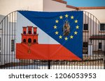 Gibraltar, United Kingdom, 2nd October 2018:- Flag of Gibraltar, EU and The Shrine of Our Lady of Europe. Gibraltar is a British Overseas Territory located on the southern tip of Spain. - stock photo