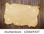 Old burnt empty paper  and decorative snowflakes - stock photo