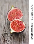 Sweet ripe fig on an old wooden board. - stock photo
