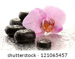 Spa stones and orchid flower, isolated on white - stock photo