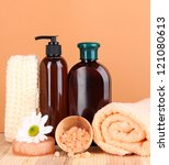 Set for care of a body on peach background - stock photo
