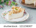 piece of cottage cheese pie with apples and almonds on a plate, closeup - stock photo