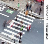 people crossing the city street on the zebra crossing - stock photo