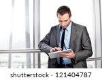 Businessman working on digital tablet - stock photo