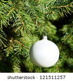 White decorative ornament on christmas tree - stock photo