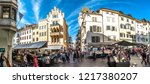 Bolzano, italy - October 19: People shopping at a famous Market Square in the old town at october 19,2018 in Bolzano in italy - stock photo