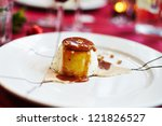 Cooked Cream on a decorated plate for Christmas lunch - stock photo