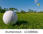 golf ball lies near green - stock photo