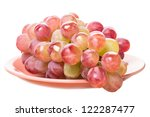 Large red grapes on a plate. Isolated on white background - stock photo