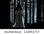 Apparitions of the female ghost in the mystical forest - stock photo