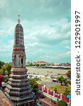 Temple of Dawn, Wat Arun, on the Chao Phraya river and dramatic sky in Bangkok, Thailand - stock photo