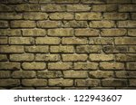 Background of aged brick wall texture - stock photo