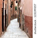 one of the narrow streets in the centre of the city of  marrakech, Morocco - stock photo