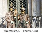 VENICE - 14 FEBRUARY: An unidentified couple dressed in unusual costumes posing curious tourists perform at the most famous European Carnival on February 14, 2010 in Venice. - stock photo