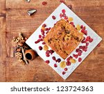 Christmas cake from above with red berries, metal tips and xmas decorations - stock photo