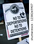 London, United Kingdom, November 17th 2018:- Anti deportation placard at the Stand Up To Racism march through central London from the BBC to near Downing Street in Whitehall - stock photo